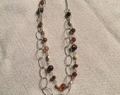 Two teared beaded necklace, silver, brown, and golds