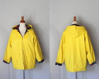 vintage yellow rain slicker with plaid lining / vintage rain coat with hood