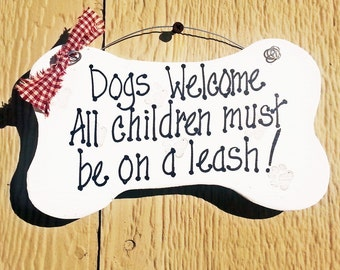 Dogs welcome, All children on a leash, bone shaped funny house signs