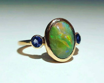 3.10 ct. Opal with .30 ct. Iolite in 14K Rose Gold