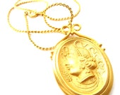 Vintage 1960's to 1970s Signed Kenneth J Lane Gold Tone Metal Grecian/Greek Woman Silhouette Oval Pendant Necklace