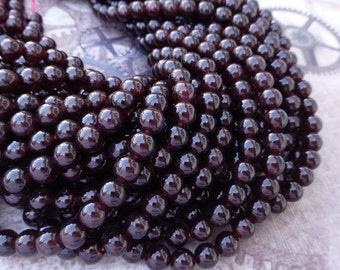 free UK postage Strand of 65 Garnet Gemstone Beads AAA Grade 6mm