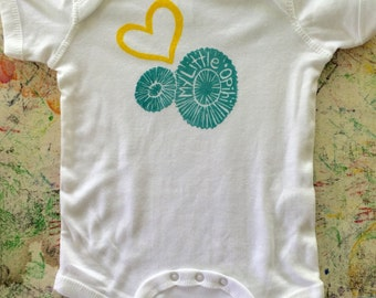 "Baby Onesie, White, with Yellow and Turquoise ""My Little ʻOpihi"" (Hawaiian Limpet) block print"