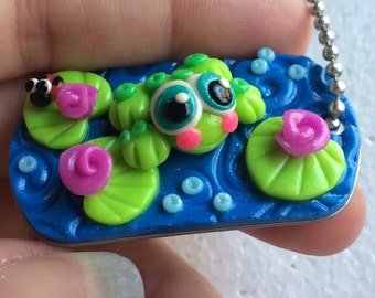 Blushing froggy and lilypad dog tag necklace