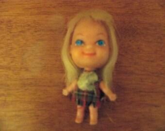 tiny mini doll