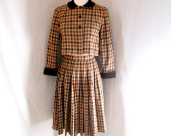 1960s women's plaid/checked suit. Velvet collar and cuffs. Two piece dress. Small. Pleated skirt.