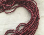 antique French steel cut bead strand  Wine red   Metal faceted seed beads 1920s Rare color
