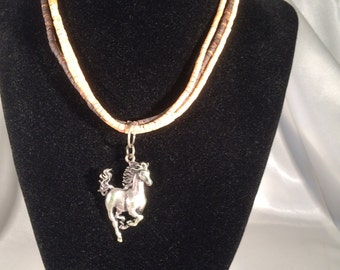Triple strand shell necklace with running horse