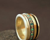 ON SALE Wide opal spinner ring , silver & gold hammered bands