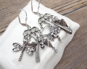 Rhinestone Chandelier Assemblage Dangle Earrings with Vintage Charms, Dragon Fly, Fairy, Hearts, Drops Silvertone Earrings