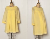 vintage 1960s maternity dress in yellow
