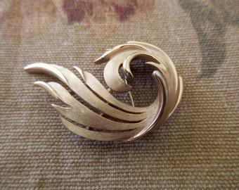 vintage Trifari brushed gold pin - goldtone, swirl