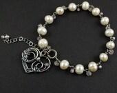 Wire wrapped bracelet, heart bracelet, white pearl bracelet, sterling silver bracelet, fine jewelry