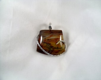 UNIQUE Petrified Wood held in Silver Pendant