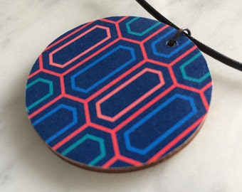 Wooden pendant, circular, geometric cellular pattern in blue-green, red, pink fashion accessory, leather cord, style 60