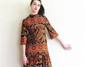 Vintage 1960s Toby Lane Day Dress in Black and Orange Paisley Print / 60s Designer Drop Waist Dress with Pleated Skirt / Medium