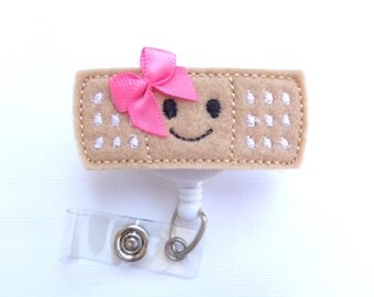 Badge Reel ID Holder Retractable - Stick it - Smiley face pink bow - tan black white felt band aid - Nurse badge reel school nurse