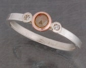 Diamond trio ring in sterling silver and 14 karat rose gold