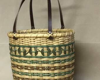 Hand Woven Basket Tote, Oval Wood Base, Brown and Light Green Accents, Brown Leather Handles