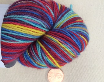 Red, Purple, Yellow, Blue, and Aqua Self Striping Sock Yarn Superwash Merino Fingering Weight