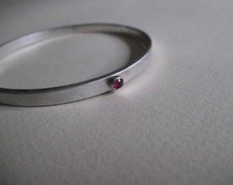 Bangle bracelet with lab grown ruby stones