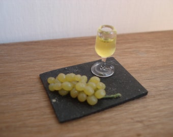 Miniature slate plate with grape and wine
