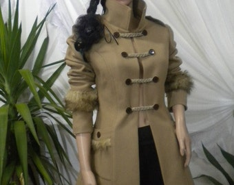Unique. beautifully and stylishly unconventional women's coat made of wool textiles.