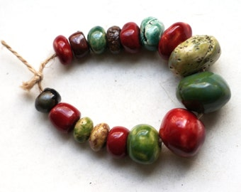 A molecular soup -- a set of 16 rustic, earthy red, green and brown ceramic art beads