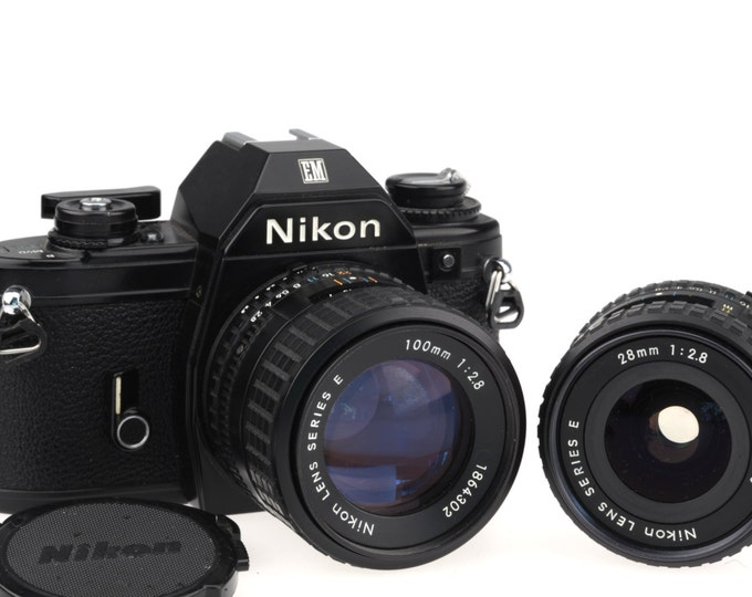 Nikon EM  Body (Black) With The Nikon Series E 28mm and 100mm 1:2.8 lens / Fully Working!