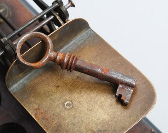 Antique rusty iron skeleton key. old patina