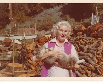 1960's blonde woman with pet cat vintage photo