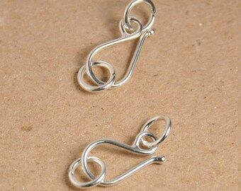 2 pieces: Sterling silver clasp, hook and eye clasp, with two 7mm OD closed jump ring, size 21x8mm