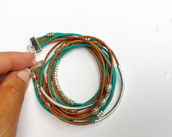 boho wrap bracelet in turquoise and brown accented with silver beads. magnet or lobster clasp.