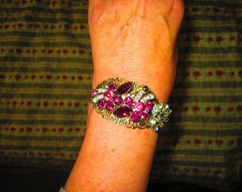 Vintage pins re-purpose into bracelet with lots of bling raspberry red.