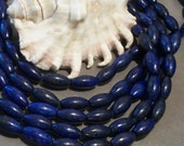 A grade Lapis Lazuli rice gemstone beads -(16 x 8 mm round) -full strand
