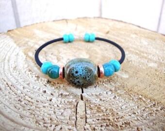 Sea Goddess- Crystal and ceramic raku beads on snap back memory wire bracelet
