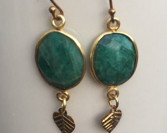 Gold and emerald earrings