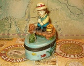 "Trinket Box, Boy Fishing, Caught Fish, Loose Fish Inside, Porcelain, Metal Fittings, 2.50""L x 3.50""H"
