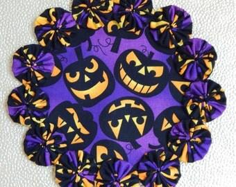 Jack O Lantern Yo Yo Doily - penny rug style for Halloween