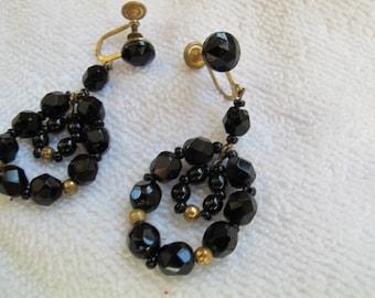 Vintage black glass bead earrings / Western Germany screw back earrings / faceted black glass dangle earrings