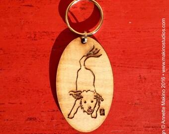 Laser-engraved wooden keychain - playful dog