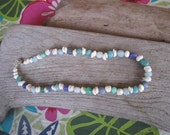 beach pebbles and puka shells necklace, gifts from the reef, made in Hawaii jewlery, surfer necklace, tropical beach glass necklace