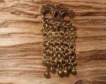 Viking era bronze bifacial pendant with Horse-Heads clatter charm or pendant