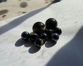 8 Black Glass Marbles, Vintage --  VP218