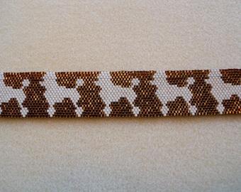 Beaded Peyote stitch bracelet. Cream Poodle with a Topaz background