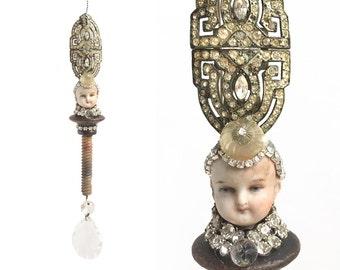 mixed media assemblage, altered art doll, rhinestone queen, doll head ornament, by Elizabeth Rosen