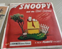 C138)  Snoopy and the Red Baron Vintage GAF View Master Reel Original Packet Set