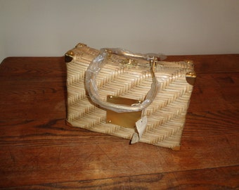 Vintage Straw Handbag Purse with the original sale tag and protective plastic on golden aluminum handles in Near Mint Condition