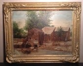 Antique oil painting on board of mill scene in gilded frame