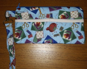 Wristlet - Blue background with sewing design